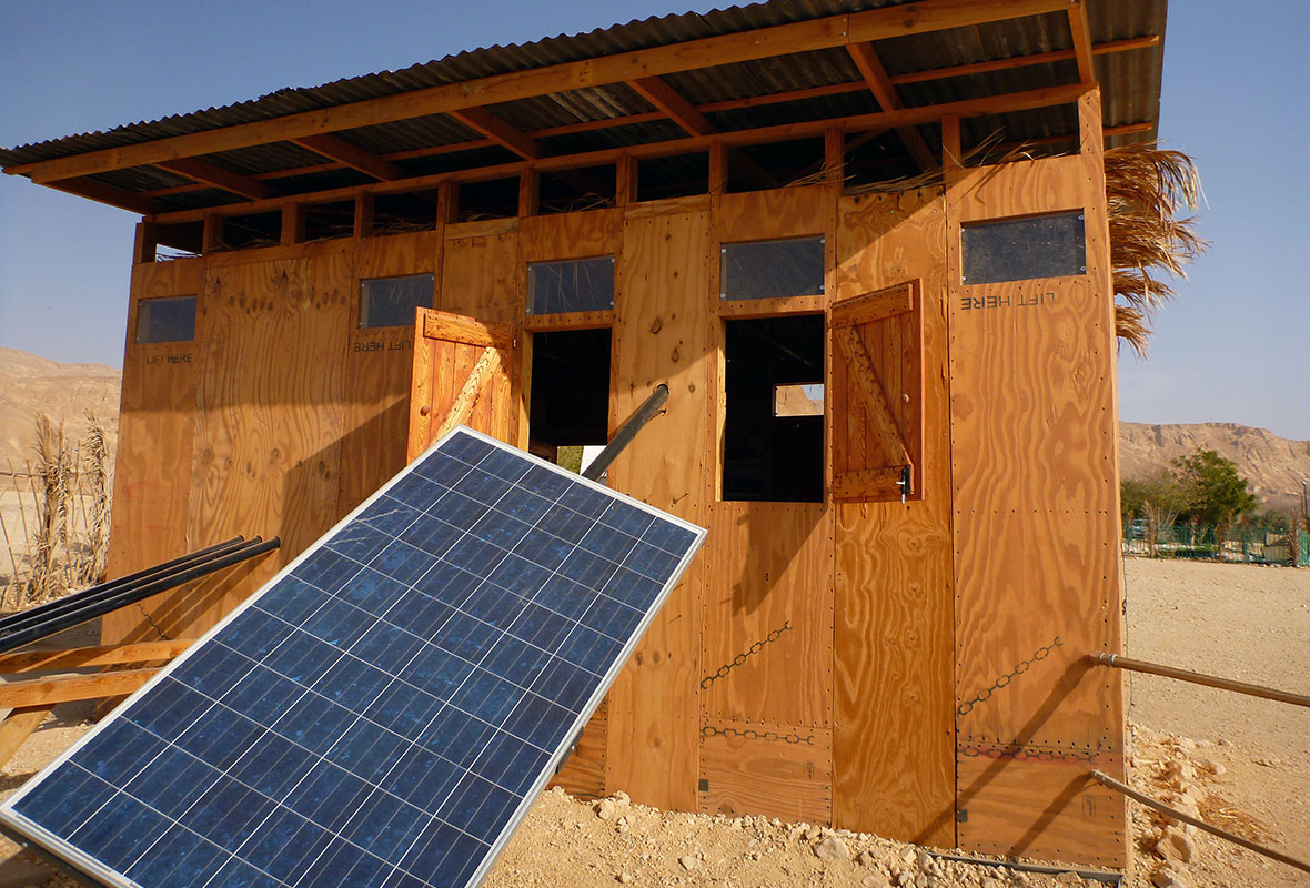 Back of urban hut with solar panel